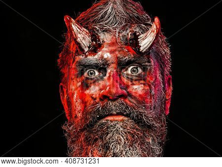Halloween, Blood On Face. Devil Horror Concept. Demon With Bloody Horns On Head. Man Evil On Black B