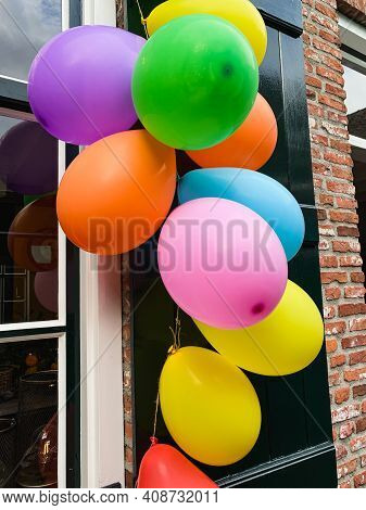 A Large Bouquet Of Bright Balloons Outdoors At The Door.