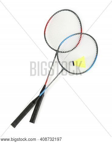 Rackets And Shuttlecock On White Background, Top View. Badminton Equipment