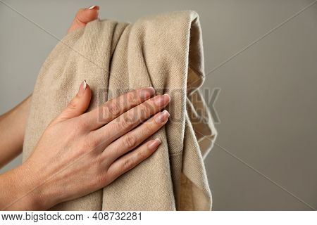 Woman With Cashmere Sweater On Beige Background, Closeup