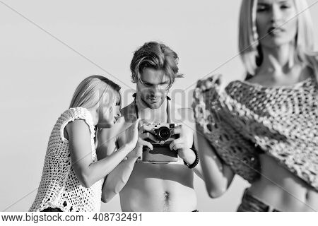 Fashion Photographer And Cute Girls Or Woman On Shooting. Sexy Female Model Posing On Foreground
