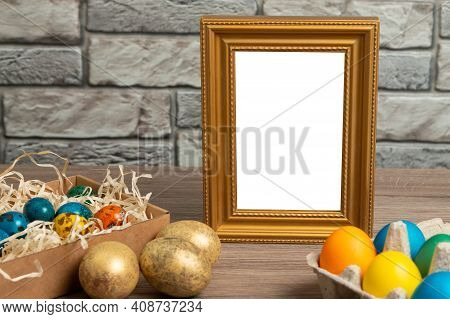 Happy Easter Concept With Easter Eggs And Copy Space. Gold Frame With Space For Text