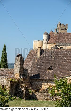 The Medieval Chateau De Beynac Rising On A Limestone Cliff Above The Dordogne River. France, Dordogn