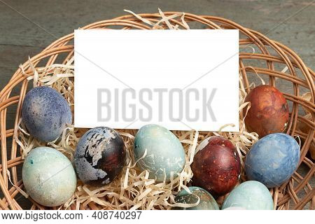 Easter Composition. Easter Eggs In A Wicker Basket With Space For Text