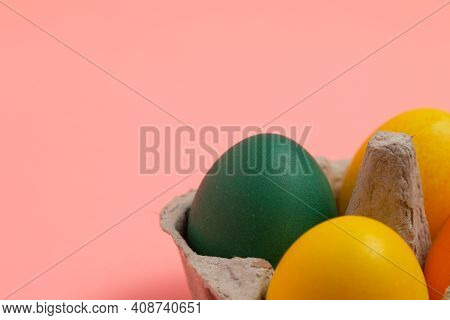 Colorful Easter Eggs On A Light Pink Paper Background