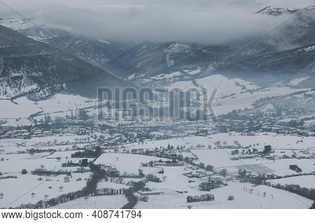 View Of Norcia Covered By Snow During Cold Day Of Winter In Umbria