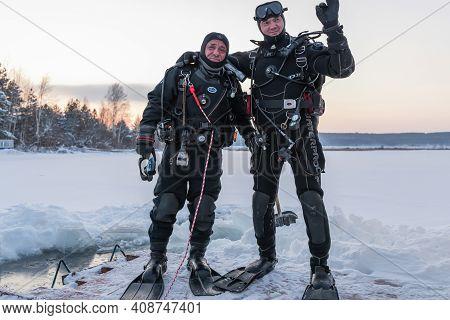 Russia, River Volga Kama - Jan 17th 2020. Two Divers Greet, Before Scuba Ice Diving. Outdoor Winter