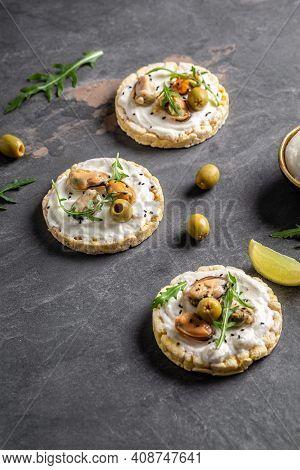 Bruschetta With Mussels, Cheese, Crisp Breads Mussels Bruschetta, Toast With Soft Cheese And Arugula