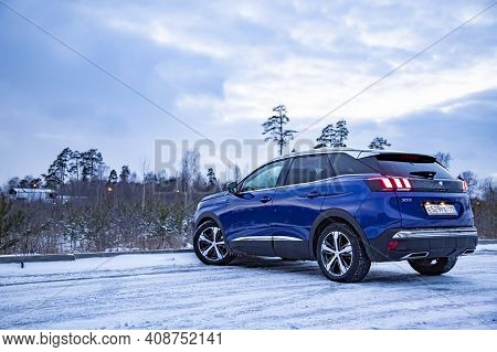 Moscow, Russia - March 15, 2020: Rear View Blue Suv Peugeot 3008 On On Winter Landscape.