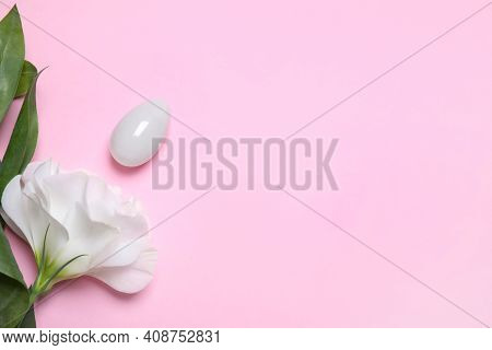 Beautiful Flower And Jade Egg On Pink Background, Flat Lay With Space For Text