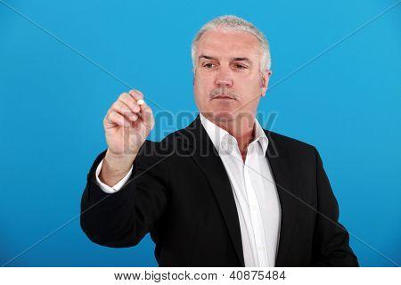 Businessman writing on a board