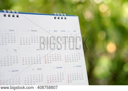 Desktop Calendar 2021 Place On Wooden Office Desk With Boke Background. Calender For Planner Timetab