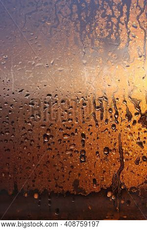 Vertical Natural Background With Water Drops On A Window With Sun Rays, Condensation On Glass With D
