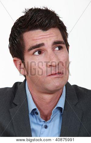 A worried businessman. poster