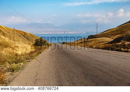 Highway To Toktogul Reservoir. Reservoir In The Territory Of The Toktogul District Of The Jalal-abad