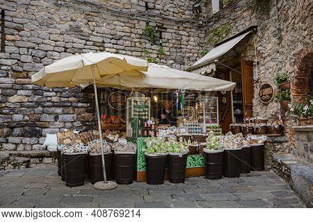 Porto Venere, Italy - October, 2020: Cityscape. View Of Outdoor Shop Board Of Wine Shop