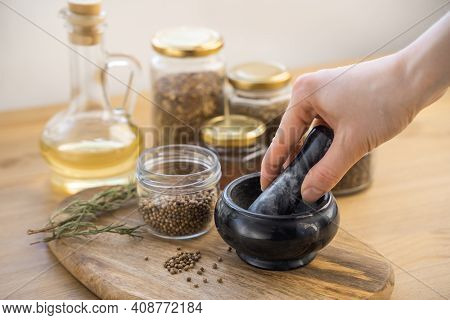 Many Different Medicinal Herbs In Wooden Spoons On A Dark Wood Background. Homeopathic Pills