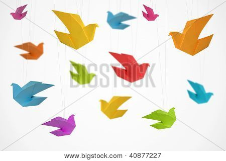Traditional origami birds on light background