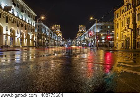 Minsk / Belarus - March 16 2019: Gates Of Minsk With The Main Train Station Behind At A Rainy Night