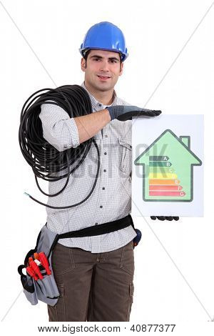 Tradesman holding an energy efficiency rating chart