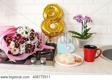 Bouquet Of Spring Flowers And Golden Ballon 8 Eight On Kitchen Table With Gift Box And Breakfast. Li