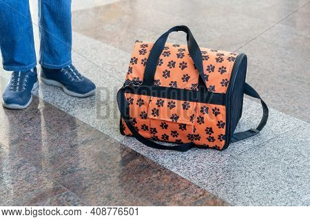 Bag For Cats And A Teenagers Legs At The Train Station. Travel With An Animal