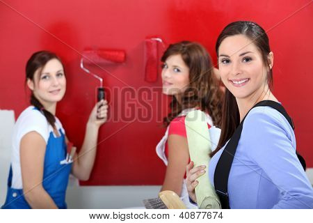 Girls painting wall