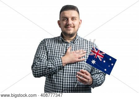 White Guy Holding A Flag Of Australia And Holds His Hand On His Heart Isolated On A White Background