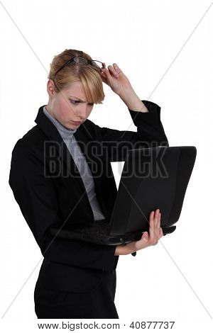 Woman frowning at her laptop