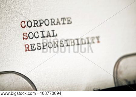 Corporate social responsibility phrase written with a typewriter.