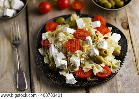 Pasta Bows With Feta And Olives. Italian Cuisine.
