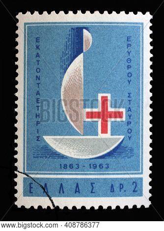 ZAGREB, CROATIA - JULY 03, 2014: Stamp printed by Greece shows Red Cross - Centenary Emblem, International Red Cross series, circa 1963