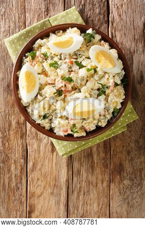 Vegetable Potato Salad With Eggs Dressed With Mayonnaise Close-up In A Bowl On The Table. Vertical T