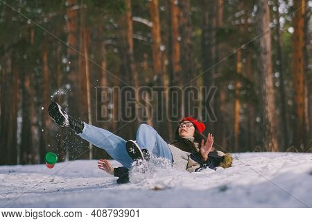 Girl Fell On The Wet Snow In The Forest. Funny Fail. The Cup Flew Out Of Hand. Be Careful On A Wet S