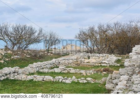 Ruins Of Antique Ancient Greek City Of Chersonesos On The Seashore, Overgrown With Trees