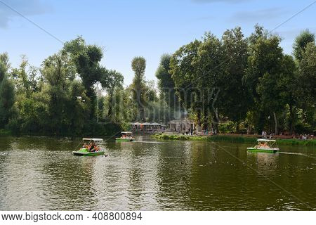 August 12, 2013: People Ride Catamarans In The Pond Of Gorky Park. Moscow. Russia.