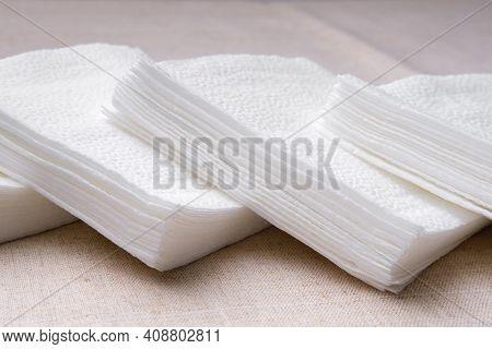 Small Stacks Of White Paper Napkins.