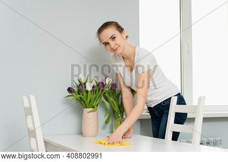 Housewife Wiping Dust Off The Table. Woman Make Daily House Chores Dust Off Using Cloth. Housekeepin