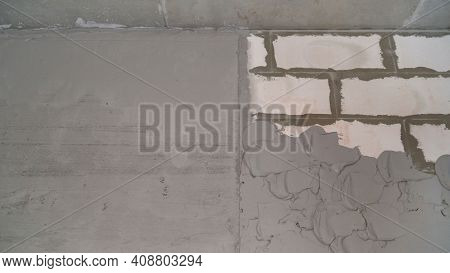 A Layer Of Wet Mortar Of Finishing Putty, Leveling The Wall, With Gypsum Plaster, Building The Backg