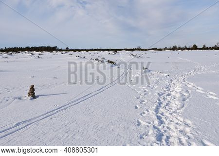 Plain Landscape With Ski Tracks By A Stone Cairn On The Island Oland In Sweden