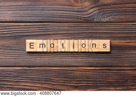 Emotions Word Written On Wood Block. Emotions Text On Cement Table For Your Desing, Concept.