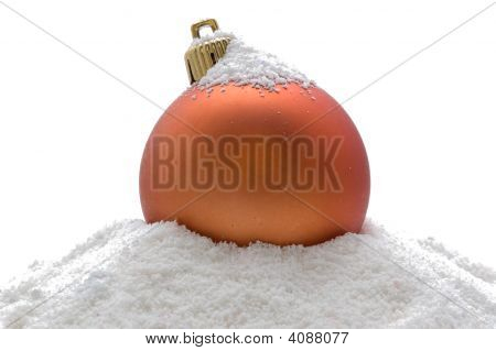 Christmas Orange Ball In Snow