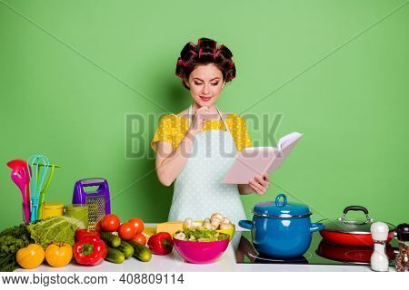 Minded Girl Read Cookbook Prepare Tasty Veggie Supper Think Choose Touch Chin Hand Table Tomato Pepp