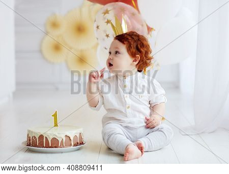 Cute Baby Boy With His First Birthday Cake At Home