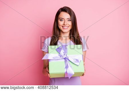 Photo Of Attractive Smiling Young Woman Hold Green Giftbox Violet Ribbon Dressed Purple T-shirt Isol