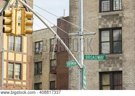 Signage Sherman And Broadway Street Sign In Uptown New York In The Bronx