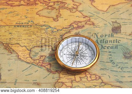 Classic Round Compass On Background Of Old Vintage Map Of World As Symbol Of Tourism With Compass, T