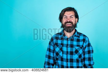Mature Barber On Blue Background. Masculinity And Charisma. Casual Fashion Style. Modern Looking Bea