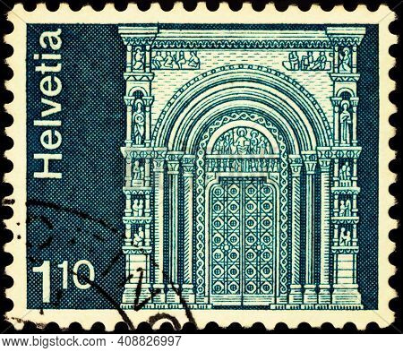 Moscow, Russia - February 18, 2021: Stamp Printed In Switzerland Shows Gallus Gate, Munster Basel. B