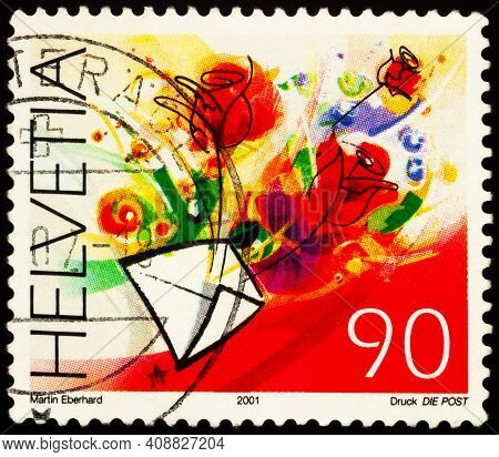 Moscow, Russia - February 16, 2021: Stamp Printed In Switzerland Shows Red Flowers And Envelope, Ser